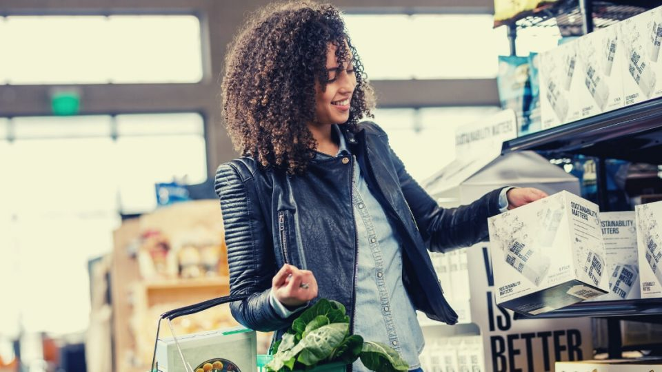 african american woman in store buying boxed water