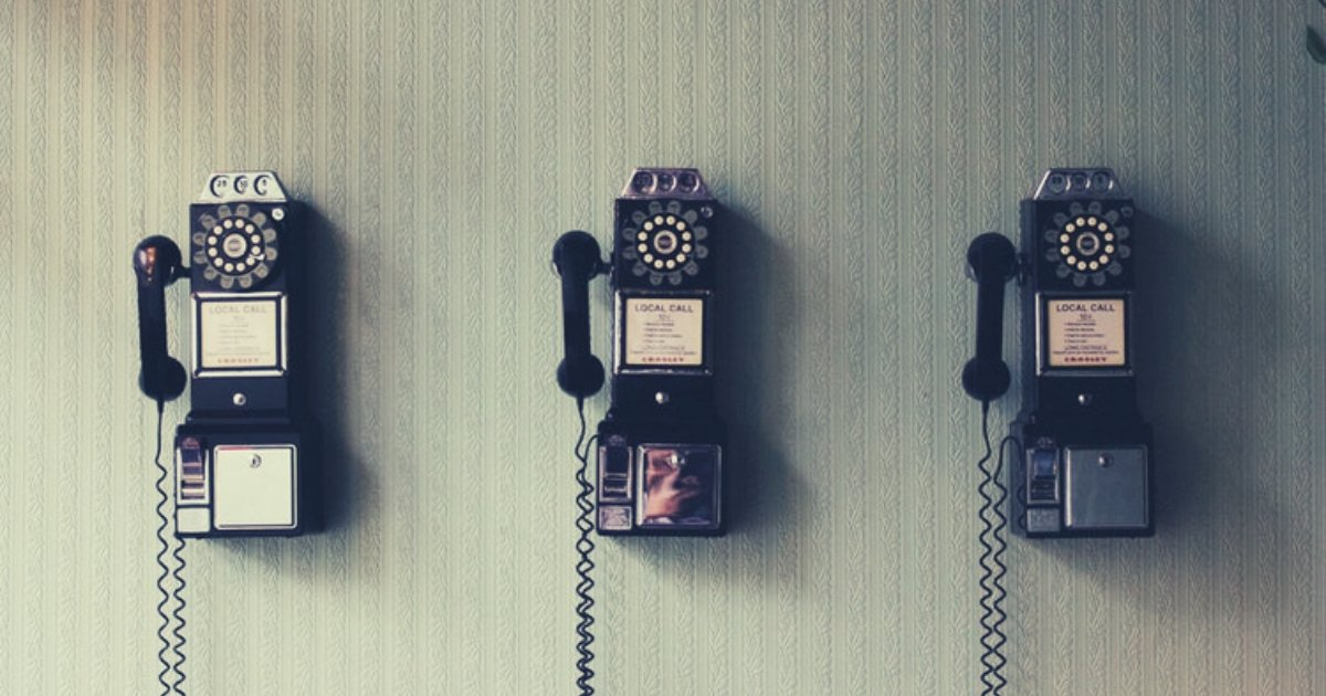 three old telephones