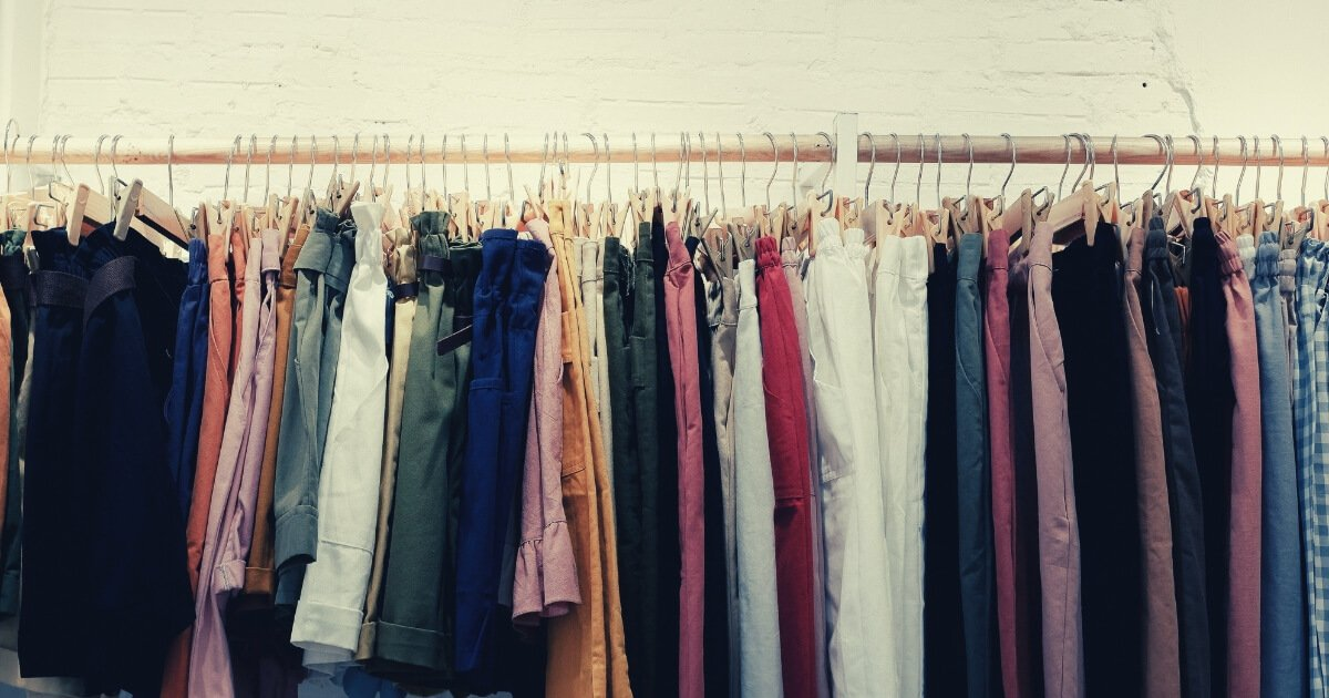 different coloured clothes on a rack in a store - evaluating alternatives