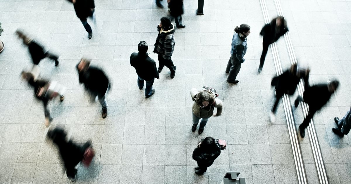 People walking swiftly at a mall