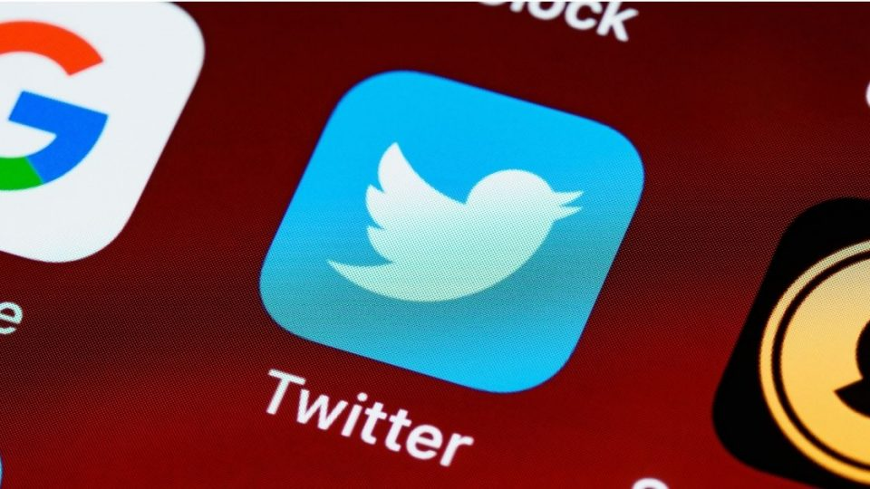 The Twitter icon on a phone screen