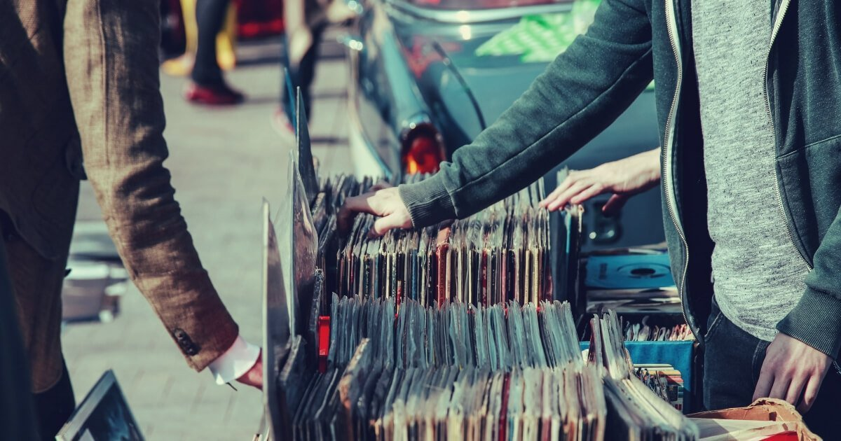 searching through a stack of vinyl records - search process