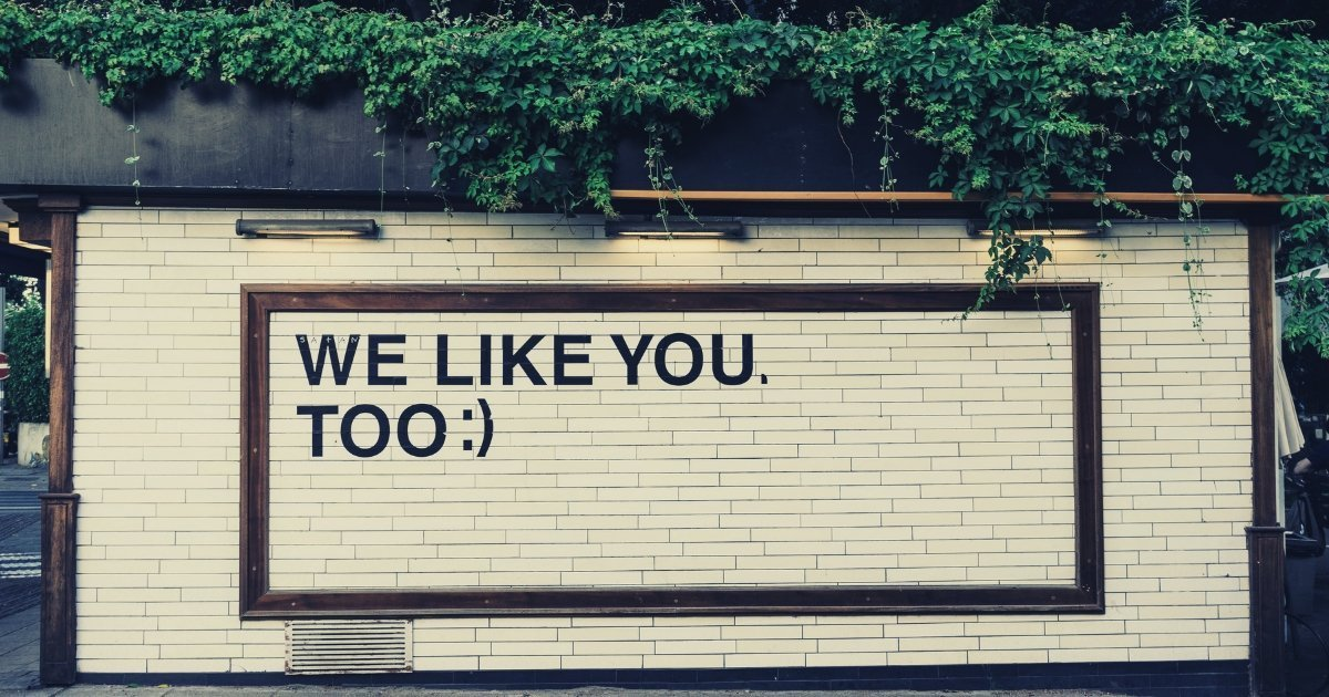 Bill board with the following words written: we like you too :)