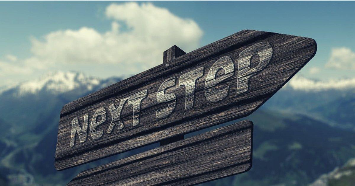 next steps wooden signpost